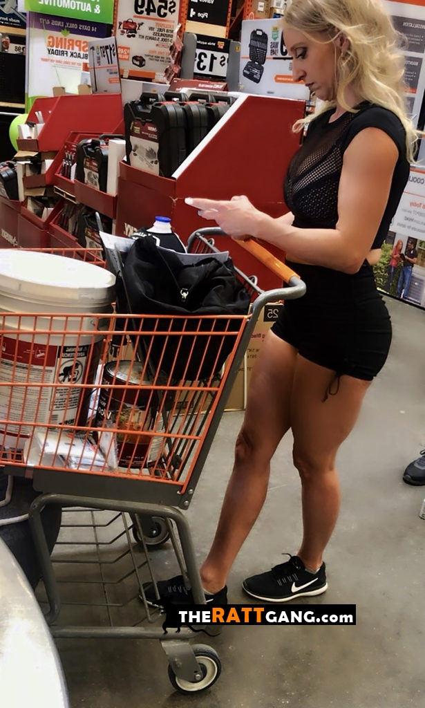 Hot milf leaning on shopping cart and texting someone