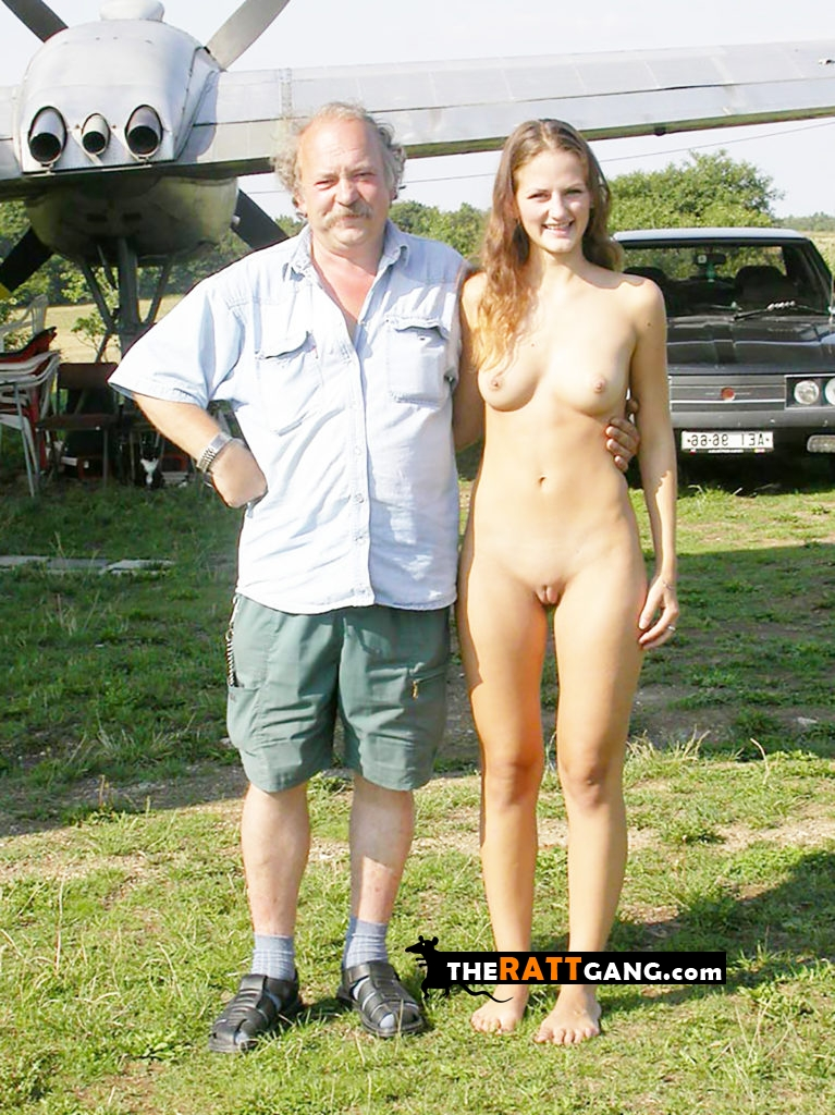 Teen girl posing naked for a photo with her embarrassed father