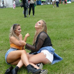 Party girls pose on the grass