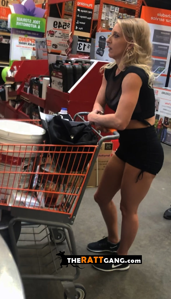 Hot milf with fit body in supermarket