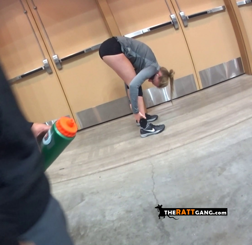 Volleyball girl stretching and bending over all the way down