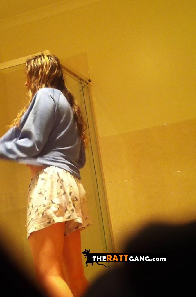 Friend's sister undressing in bathroom